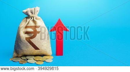 Indian Rupee Money Bag With Red Arrow Up. Raising Taxes. Deposit Interest. Increase In Profitability
