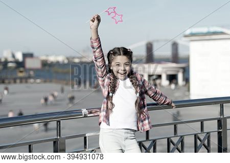Absolutely Thrilled. Happy Party Girl On Urban Background. Adorable Girl Holding Prop Glasses For Pa