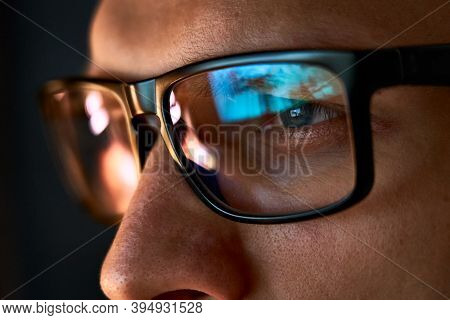 Close Up View Of Focused Businessman Wears Computer Glasses For Reducing Eye Strain Blurred Vision L
