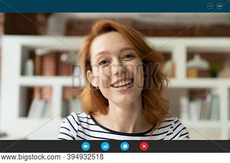 Smiling Young Red-haired Woman Holding Distant Video Call Conversation.