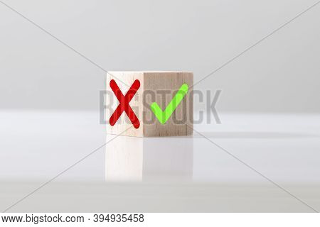Yes Or No Symbols On Wood Blogs Cube On Light Background. The Concept Of Choice And Making The Right