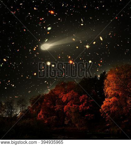 Meteorite Against Autumn Bright Forest At Night. Elements Of This Image Furnished By Nasa