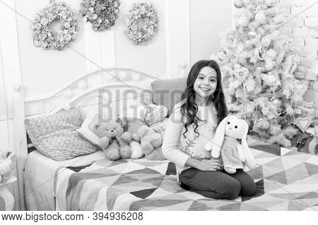 Merry Xmas To You. Happy Child In Bedroom With Xmas Tree. Little Girl Smile With Toys On Xmas Eve. X