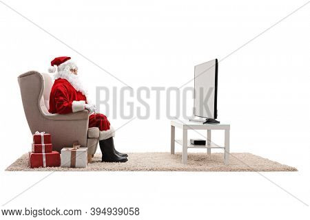 Santa claus watching tv with presents on the floor isolated on white background