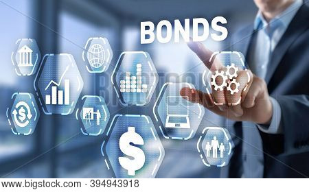 Corporate Bonds Concept. Man Presses His Finger On The Inscription Bonds.