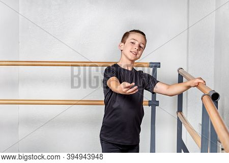 Portrait Of A Sporty Young Guy. Training In Ballet And Gymnastics.