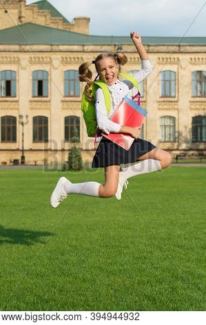 Energetic Child In Formal Uniform With Study Books Backpack Jump In Schoolyard Happy Celebrating, Ba