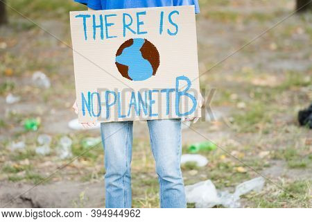 Cropped Of Volunteer Holding Placard With Globe And There Is No Planet B Inscription, Ecology Concep
