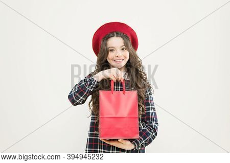 Easy To Use Bag. Happy Girl Holding Shopping Bag On Yellow Background. Little Child Smiling With Pap