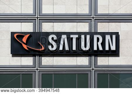 Berlin, Germany - July 12, 2020: Saturn Store Logo On A Wall. Saturn Is A German Chain Of Electronic