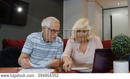 Worried Senior Retired Couple Checking Calculating Bills Bank Loan Payment Doing Paperwork Discuss U