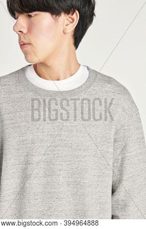 Asian man wearing a gray sweatshirt mockup
