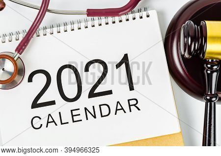 2021 Calendar And Stethoscope Medical With Wooden Judge's Hammer. Health Law Concept.