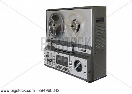 Stereo Tape Deck Recorder Player With Reels On Background.