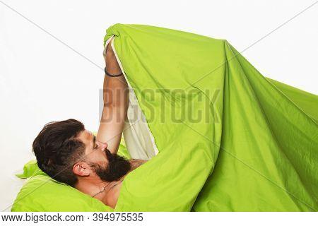 Sexual Potency. Imitating Erection. Joyful Man Sleeping On A Bed. Wake Up Sleepy