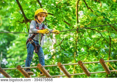 Kids Boy Adventure And Travel. Adventure Climbing High Wire Park. Early Childhood Development. Cute