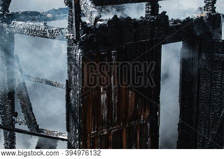 Aftermath Of Fire Disaster. Smoke After Great Fire. Burned Down To The Ground Wooden House