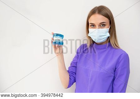 Doctor In A Medical Mask And Braces System In His Hands