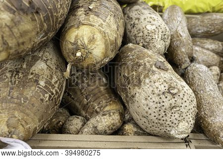 Coco Yam Taro Root On Display In Produce Section Of Supermarket