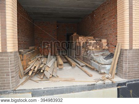 The Storage Of Building Materials Such As Bricks, Wooden Planks, Rafters, And Roof Beams Inside Of T