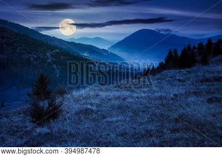 Foggy Morning In Carpathian Countryside At Night. Village Down In The Rural Valley. Trees In Fall Fo
