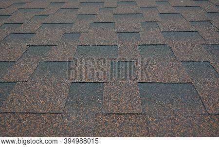 Asphalt Shingles Textured Background. A Close-up On Copper Brown Dimensional, Or Architectural Roofi