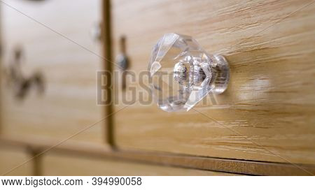 Wooden Box With A Crystal Handle. Chrome-plated Handle. The Handle On The Front Of The Cabinet. Deco