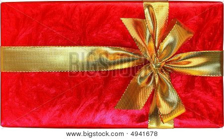 Red Gift With Gold Bow Isolated On White Background