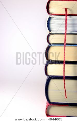 Stack Of Books In A Tower With A Red Bookmark