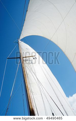 Sail and mast on yacht view from deck of boat poster