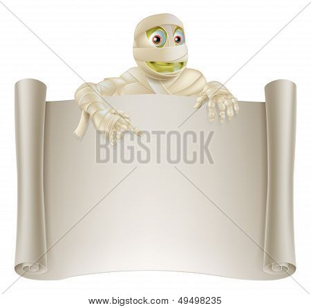 An illustration of a Halloween mummy character on top of a scroll sign or banner and pointing at it poster