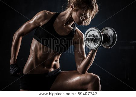 Brutal athletic woman pumping up muscules with dumbbells poster