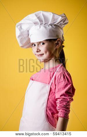 Little girl chef in uniform