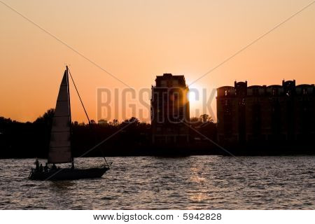 Boat And Skyline At Sunset