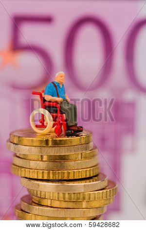 woman in wheelchair on money stack, symbol photo for disability care allowance and costs gesunheitswesen