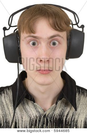 Amusing Young Man In Ear-phones With Protruding Eyes