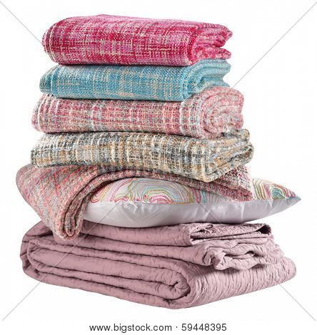 Bedding objects, pillow and bed spreads isolated.