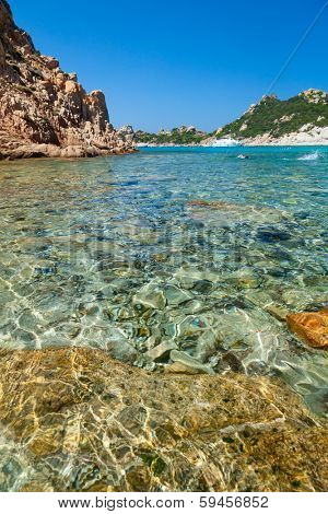 Clear turquoise water of Cala Corsara cove at Maddalena Archipelago in Sardinia