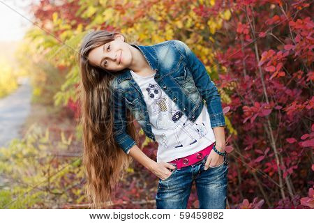 Pretty teenage girl in the autunm park