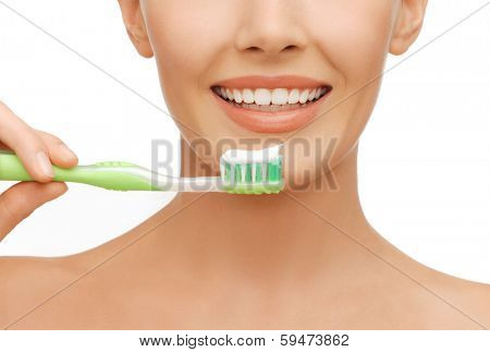 beauty and dental health concept - beautiful woman with green toothbrush