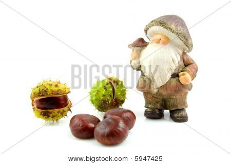 Stone Autumn Doll With Chestnuts