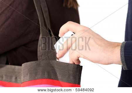 Pickpocket are stealing mobile phone from bag, close up, isolated on white