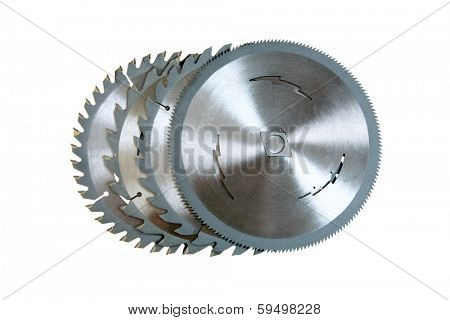 Four Genuine Circular Saw Blades each with a different cutting specification from wood rip saw to fine tooth finishing blades. Isolated on white with room for your text. Saw blades are very sharp.