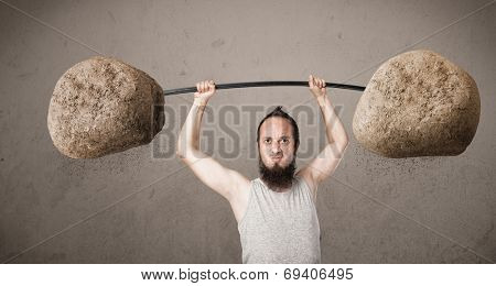 Funny skinny guy lifting large rock stone weights poster