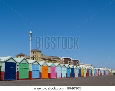 Beach huts or sheds, in a colourful row.