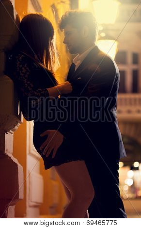 Man And Woman Kissing At Night