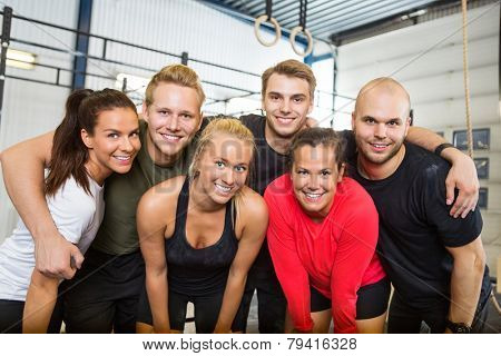 Group portrait of happy people standing together at cross training box