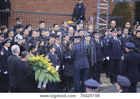 Widow receiving flag from officer