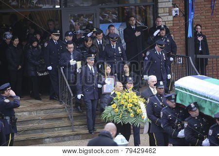 Family follows flag-draped coffin