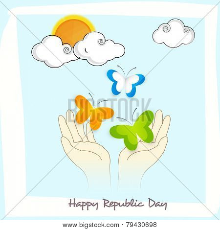Human hands releasing butterflies in national flag colors on skyblue background for Happy Indian Republic Day celebration.